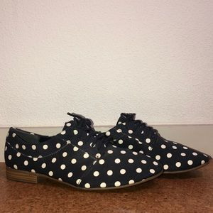 Navy blue polka dot Gap shoes.